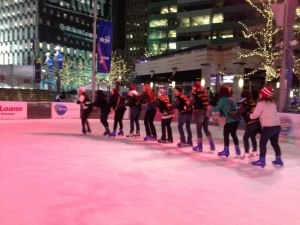 Several language club members do the conga across the icy rink.